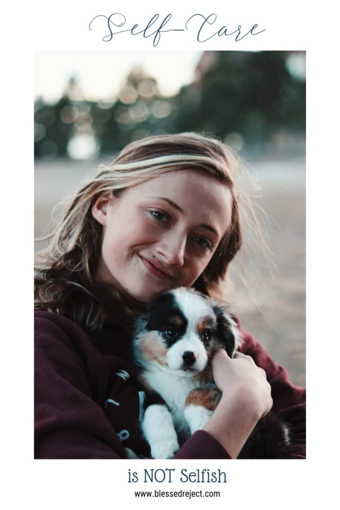 woman hugging cute puppy - self care is not selfish