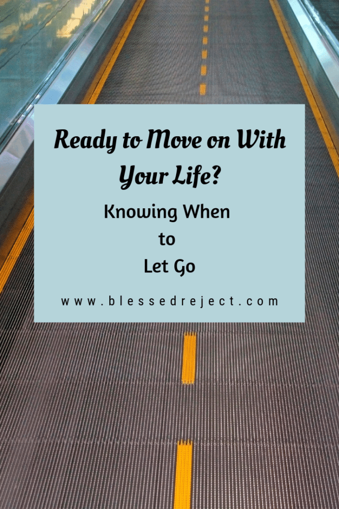 Photo of moving walkway with text overlay: Moving on With Your Life