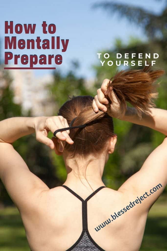 woman prepares to defend herself